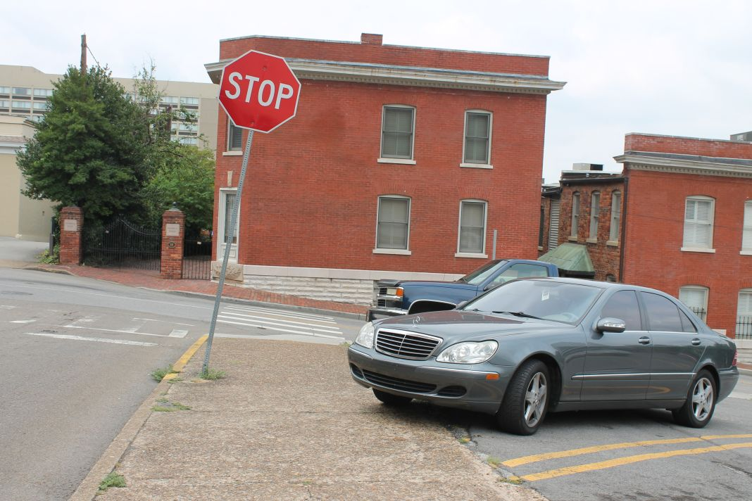 Listing Stop Sign Car Parked On Sidewalk Union Avenue At Locust