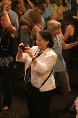 Mayor Rogero takes a photograph in the rain of the Lonesome Coyotes, Bob Dylan Birthday Bash, Market Square, Knoxville, June 2013