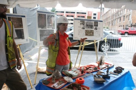 Jessica Stanton, Project Supervisor, explains artifacts at TVA site, Knoxville, July 2013