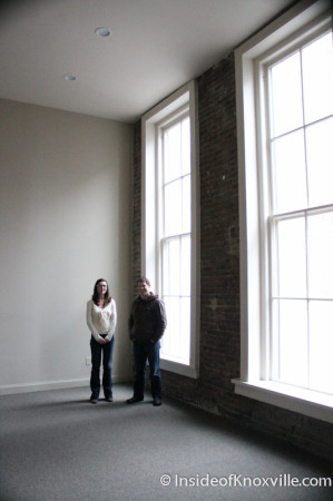 Jenny Brown and Patrick King beside the massive rear windows, Century Building, 312 S. Gay Street, Knoxville, February 2014