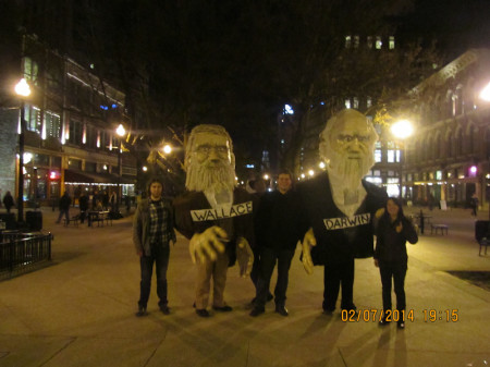 Wallace and Darwin in Market Square, along with (left to right) Ecology and Evolutionary Biology graduate students John Reese, Cedric Landerer, and Angela Chuang.
