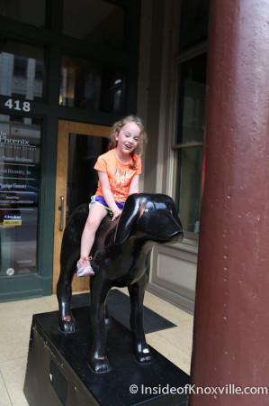 Urban Girl Rides the Art Dog outside the Phoenix Building, Knoxville, Spring 2014