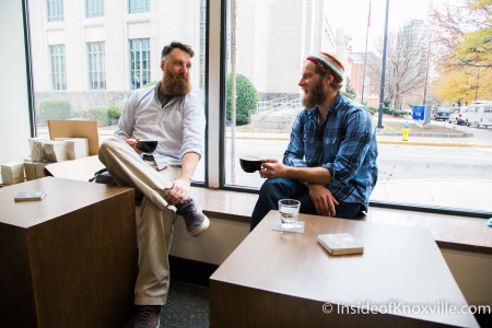 Ben and friend enjoy a cup of coffee at the tables he designed and built.