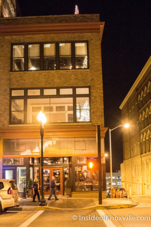 Tailor Lofts and Five Bar lighted and alive at Christmas.