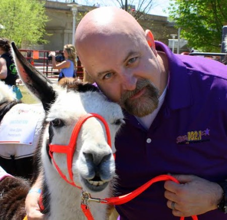 Marc Anthony of Star 102.1 with his West High School llama. (Photo Heidi Hornick)