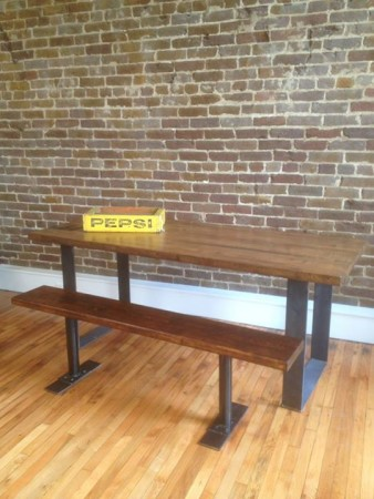 Industrial-style tables constructed by Charlie Havener from re-puposed materials